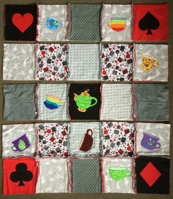 Applique rag quilt laid out
