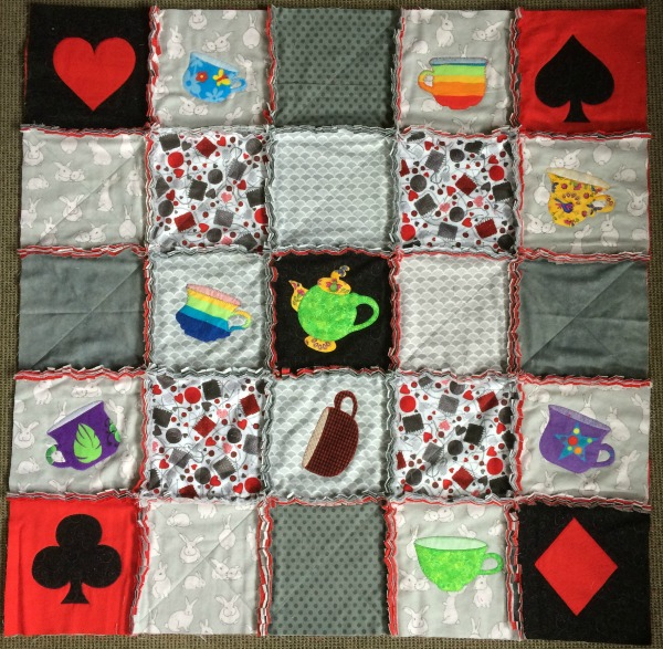 Applique rag quilt blocks stitched into rows
