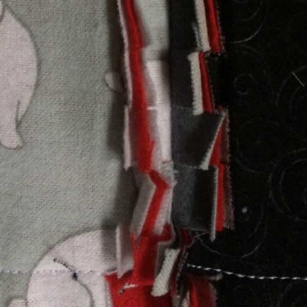 Triple stitched egde