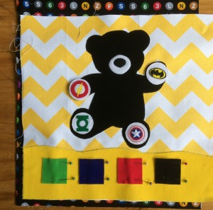 Busy book Super Ted with 4 super hero emblems