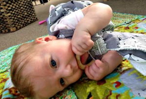 Baby with wooden teether ring