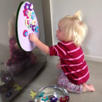 Cassie (16months) decorating the felt Easter egg while big sisters are away