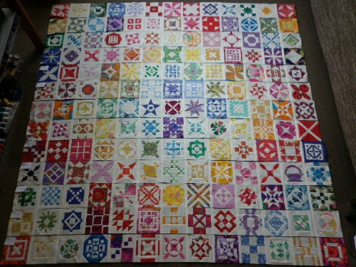 DJ quilt top with blocks stitched in rows