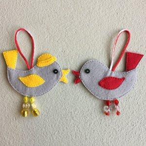 Felt bird decoration made for the child's felt Christmas tree