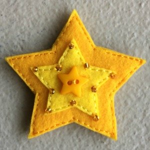 Wee two toned felt star to place on the Christmas tree