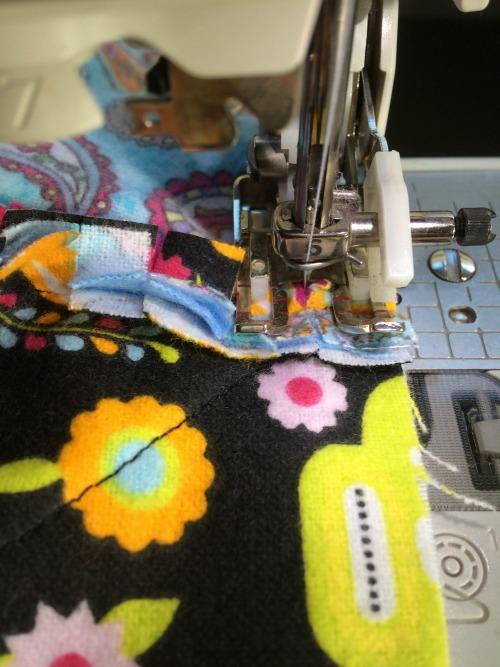 Close up of sewing over block seams