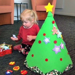 Cassie decorating her felt Christmas tree